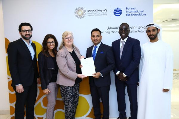 Sajid Barkat, CEO, AS World Group (3rd from right) being awarded the Authorised Ticket Reseller contract by Lisa Caudana, Director, Ticketing - Sales and Marketing, Expo 2020 Dubai (3rd from left).